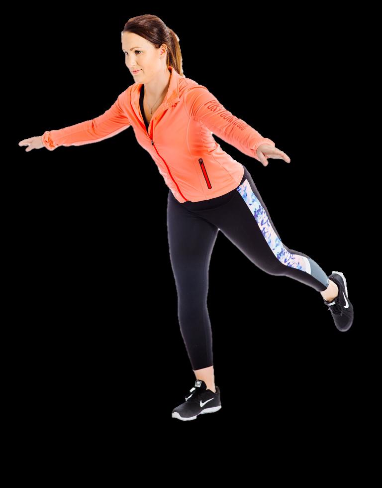 Nainen tasapainoilee seisten, toinen jalka nostettuna takaviistoon.